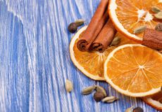 Dry slices of orange, cinnamon, allspice and cardamom on a blue wooden background. Dry slices of orange, cinnamon, allspice and cardamom on blue wooden royalty free stock image