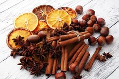 Dry slices of orange, cinnamon, cloves and cardamom.  Royalty Free Stock Photos