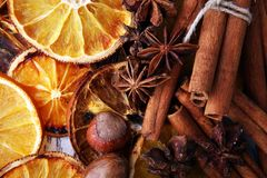 Dry slices of orange, cinnamon, cloves and cardamom.  Stock Photos