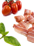 Dry smoked ham tomato and basil isolated on white Royalty Free Stock Photography