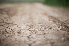 Dry soil background dof close up blubbered path nature fresh ground hiking. Dry soil texture brown background outdoors nature ground countryside crop dof dryness Royalty Free Stock Photo