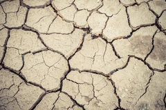 Dry soil cracked earth texture vintage fillter. Dry soil cracked earth texture royalty free stock photos