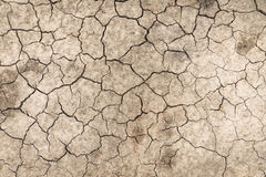 Dry soil cracked earth texture vintage fillter. Dry soil cracked earth texture stock photo