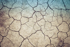 Dry soil cracked earth texture vintage fillter. Dry soil cracked earth texture stock photos