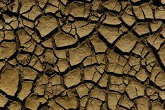 Dry soill with crevices. Dried river bed surface with crevices royalty free stock photo