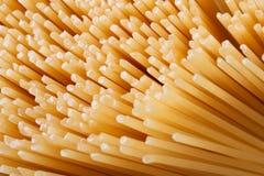 Dry spaghetti closeup texture. background. macro. Top view Royalty Free Stock Photos