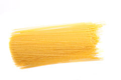Dry Spaghetti Noodles on a White Background royalty free stock photos