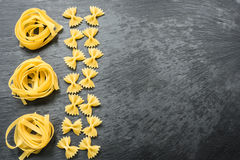 Dry spaghetti, penne, tagliatelle and farfalle Royalty Free Stock Images