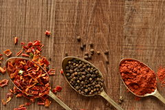 Dry spices in old spoons Stock Photo
