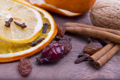 Dry spices, raisins, cinnamon, cloves, rose hips Stock Photo
