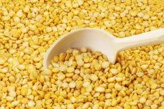 Dry split peas on wooden spoon Royalty Free Stock Photo