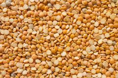 Dry Split Yellow Peas Background. Healthy Vegetarian or Vegan Food Texture. royalty free stock photo