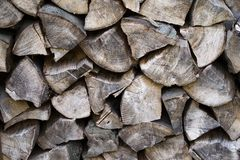 A old and dry stack of firewood. A picture of an old and dry stack of firewood. Pieces of old wood royalty free stock images