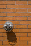 Dry Standpipe. On brick wall, with peeling chrome coating Royalty Free Stock Image