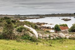 Dry Stone Building in Connemara, Galway. Old dry stone building by the sea in the Connemara region of County Galway. The town of Clifden is nearby to the north Stock Photos