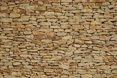 Dry stone wall. Background of textured brown dry stone wall Stock Photo