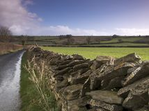 Dry stone wall. Along a country lane Royalty Free Stock Images