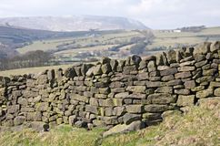 Dry stone wall. Between fields Stock Photos