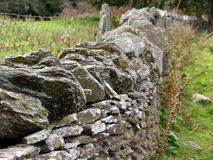 Dry Stone Wall. A section of dry stone wall alongside farmland Stock Photography