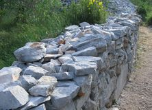 Dry stone wall along a trail Royalty Free Stock Photo
