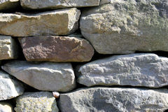Dry stone wall background Stock Images