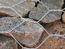 Dry Stone Wall Closeup. Close up of a dry stone wall retained by strong wire Royalty Free Stock Image