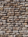 Dry stone wall, Corsica, France. Close up of a mediterranean limestone wall Stock Photo