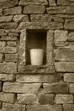Dry-stone wall. Dry stone wall in my garden ,with alcove and container, sepia toned. North Yorkshire England Stock Photography