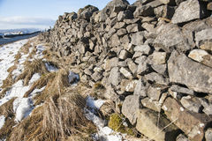 Dry stone wall in the english countryside. Old dry stone wall in an english countryside rural landscape scene Royalty Free Stock Images