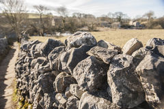 Dry stone wall in the english countryside. Old dry stone wall in an english countryside rural landscape scene Royalty Free Stock Image