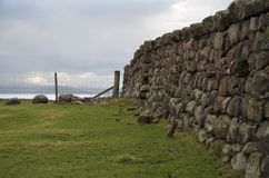Dry stone wall and fence in Scotland Stock Photo