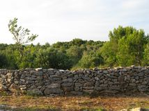 A dry stone wall on a isle in the Mediterranean Stock Photos