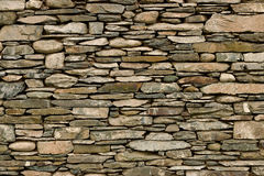 Dry stone wall. Natural stone wall hand crafted by an experienced mason, great background or wallpaper for builders Stock Photography