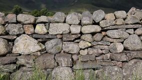 Dry stone wall with no mortar from north of England in the Lake District National Park uk. Dry stone wall with no mortar from north of England in the Lake stock footage