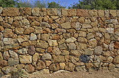 Dry stone wall in the park Royalty Free Stock Images