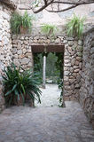 Dry stone wall portal with plants. Dry stone wall portal with plants, rural Majorca Stock Image