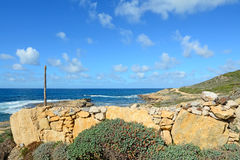 Dry stone wall by the sea Stock Image