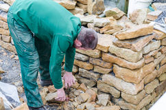 Dry stone wall, Stone Wall,. Sand stone wall for a raised bed. Create a dry stone wall Stock Photos