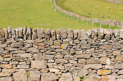 Dry stone wall traditional construction The Gower Peninsula South Wales UK with no mortar Royalty Free Stock Image