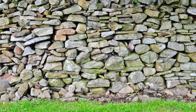 Dry stone wall in the Yorkshire Dales. A handbuilt traditional dry stone wall in the heart of the Yorkshire dales Royalty Free Stock Images