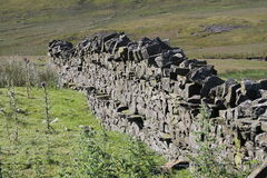 Dry stone wall Yorkshire Dales heather on hillside. Good resolution of Dry stone wall Yorkshire Dales, hillside heather Royalty Free Stock Photos