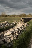 Dry stone walling. A dry stone wall taken apart for repair Stock Photos