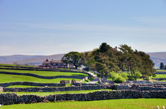 Dry stone walls and farm. Royalty Free Stock Photo