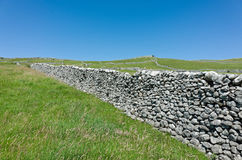 Dry stone Walls - Yorkshire Dales, England. Traditional dry stone walls in the rural landscape near Malham, Yorkshire Dales, England, UK Royalty Free Stock Photo