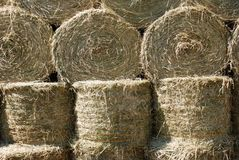Dry straw bales background. Dry straw bales in a barn Stock Photo