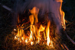 Dry straw fire. Fire over dry straw in the night Stock Photos