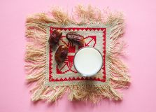 Dry tasty dates and milk on pink background. Dry dates and milk on pink background Stock Photos