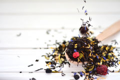 Dry tea with berries and petals fray on the table stock image