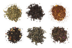 Dry tea collection  on white background. Set of six tea piles Royalty Free Stock Images