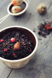 Dry tea with dried berries Stock Photo